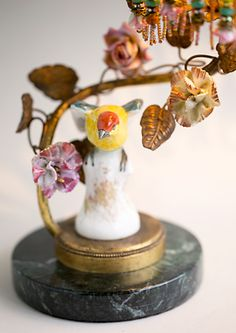French antique lamp with a bird figurine