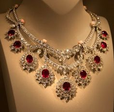 Van Cleef & Arpels necklace made of diamonds, conch beads and rubies, 2014 . Ruby Jewelry, Royal Jewelry, High Jewelry, Luxury Jewelry, Indian Jewelry, Jewelery, Diamond Jewelry, Ruby And Diamond Necklace, Diamond Necklaces