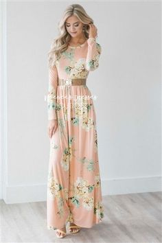 The perfect Spring maxi dress is here! Stunning, soft and comfortable, The Jaylee is a must have. Beautiful light peach dress features a floral print, long sleeves, round neckline, elastic waist and side seam pockets. #Floral