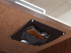 Be prepared for anything the rat race throws at you by keeping your piece handy with the under desk gun holster. The tough synthetic plate features an elastic holster able to accommodate virtually any type of handgun so it's always there when you need it. Hidden Gun Safe, Hidden Gun Storage, Secret Gun Storage, Just In Case, Just For You, Secret Hiding Places, Hidden Spaces, By Any Means Necessary, Gun Holster
