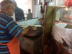 Cooking chapati at Azmi's