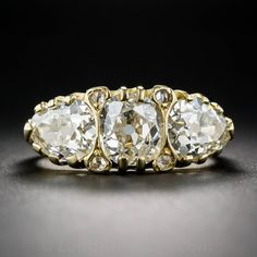 2.66 Carats English Three-Stone Diamond Gold Ring | From a unique collection of vintage three-stone rings at https://www.1stdibs.com/jewelry/rings/three-stone-rings/