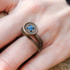"""Buttonhole Ring Bronze  by Erica Schwartz, 38% off (""""This ring looks like a button, but don't be fooled—it's actually one continuous piece of stainless steel made using 3D printing technology. Infused with bronze, the ring features colored thread as decoration. In this ring, you'll look cute as a...Well, you know."""")"""