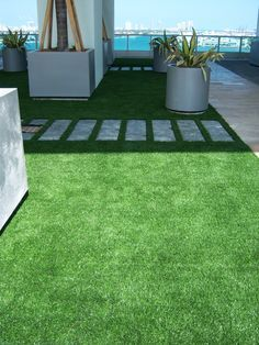 fake turf, pavers, large pots for specimin plants. synthetic turf modern gardens - Google Search