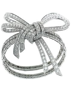 Ribbon inspired bracelet, with diamond details. This would look really cute without all the diamonds.