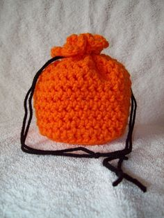 Crochet Mini Drawstring Pumpkin Bag by stitchinthenightaway: Handy little bag to make from scrap yarn. Change up the colors to suit the occasion! #DIY #Crochet #Craw_String_Bag #stitchinthenightaway