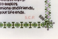 Baptism Sampler. Cross stitch worked on 28-count evenweave fabric. Detail, bottom right corner.