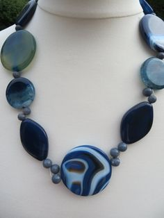 Check out this item in my Etsy shop https://www.etsy.com/listing/231895445/agate-gemstone-necklace-blue-marbled