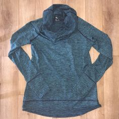 Reebok PLAYWARM cowl neck pullover workout jacket Reebok PLAYWARM pullover cowl neck jacket.  This is warm enough for running or working out on cold days.   Navy and turquoise pattern on front and back. Keyhole for thumbs on each arm. Worn only once - perfect condition - matches the Reebok pants - bundle for savings!! Size LARGE Reebok Tops