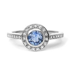 Arabel Lebrusan Efflorescence ethical light blue sapphire engagement ring with white diamonds set in Fairtrade white gold. http://www.thejewelleryeditor.com/shop/product/arabael-lebrusan-efflorescence-ethical-light-blue-sapphire-engagement-ring-fairtrade-gold/ #jewelry