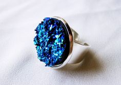 A gorgeous, sparkly, highly detailed deep blue or velvety black resin druzy stone, mounted to a quality bright silver adjustable size ring.  #galaxy #ring