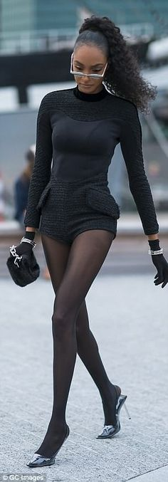 521f8ba959 Dressed to impress: Jourdan arrived to the fashion show in sky-high heels  and tights. She paired her all-black ensemble with gloves, silver bangles,  ...