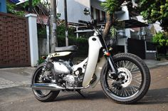 "Street Cub "" Stronghold "" by Newspeed Garage. A Street Cub with classy look but we put Engine for this one, classy and rough Honda Cub, Barrel Of Monkeys, Bike Wear, 125cc, Old Bikes, Mini Bike, Bike Design, Enduro, Custom Bikes"