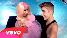 Justin Bieber - Beauty And A Beat ft. Nicki Minaj.  Fun video and song!  I want to go to a water park all lit up at night and dance/play!