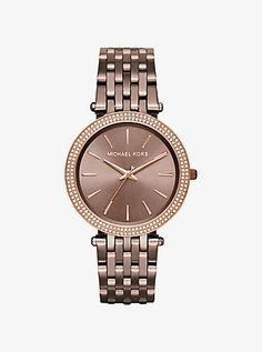 Michael Kors Darci Pavé Sable Watch   A little glam, a little girl next door—our Darci watch delivers chic attitude every time. A pavé-embellished bezel and radiant rose golden accents shine against the rich, sable-hued setting. Pair it with delicate rose gold midi rings and bangles for an elegant mix.