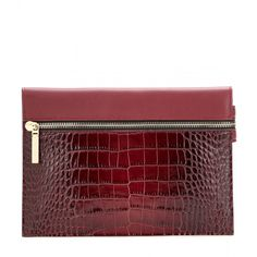 Victoria Beckham Small Zip Embossed Leather Clutch (600 CAD) ❤ liked on Polyvore featuring bags, handbags, clutches, red, embossed leather purse, red purse, real leather purses, leather clutches and red leather handbag