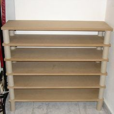 MDF boards +toilet paper cardboard cylinders= shoe storage & you could sand the shelves & paint this to suit your tastes ~ Kel