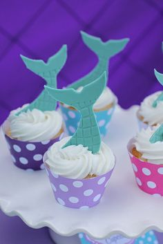 Tail topped cupcakes at a Little Mermaid Birthday Party!  See more party ideas at CatchMyParty.com!