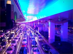 Shanghai Puxi highway is underlined with purple lighting. I can see this from my 29th floor apartment every night
