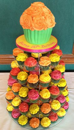 Colourful rose piped wedding cupcakes with giant cupcake top tier