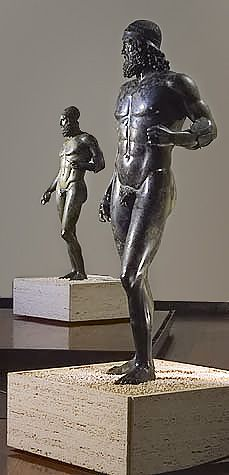 """The Bronzi di Riace (Italian for """"Riace bronzes"""") are two famous full-size Greek bronzes of nude bearded warriors, cast about 460–430 BC and currently housed by the Museo Nazionale della Magna Grecia in Reggio Calabria, Italy. The Riace Warriors are respectively termed """"A"""" and """"B""""."""