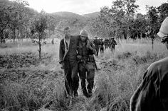 """""""A wounded American soldier returning to the X-ray landing zone in the Ia Drang Valley, South Vietnam, November Credit: Neil Sheehan/The New York Times"""" Vietnam History, Vietnam War Photos, American War, American Soldiers, New York Times, Battle Of Ia Drang, War Novels, Afghanistan War, South Vietnam"""