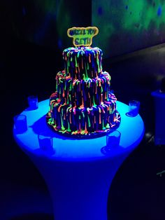 Wow your guests with a glow in the dark party, topped off with a neon and glow in the dark cake!