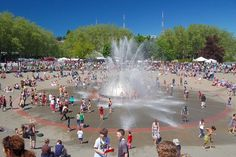 On a Sunny Summer Day, get wet with the kids at the International Fountain at the Seattle Center.