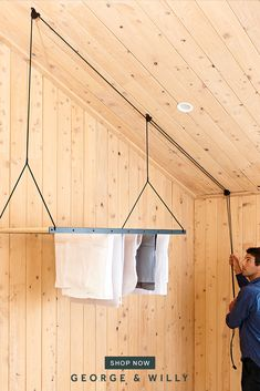 An everyday essential we can all use.Suspended from the ceiling using a seamless pulley system and crafted from timber and aluminum the Hanging Drying Rack is an economical, and environmental way to dry and air clothing. Hanging Drying Rack, Drying Rack Laundry, Clothes Drying Racks, Laundry Room Inspiration, Laundry Room Design, Room Decor Bedroom, Minimalist Design, Interior Design Living Room, Diy Home Decor