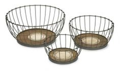 """Benito Wood and Metal Baskets - Set of 3 - This set of three Benito grape picking baskets with the Wine Growers Association emblem of San Benito county are made from recycled wood and wire frames and come in a set of three sizes. This is a beautiful set that is great to have for a variety of uses. 50% Recycled Wood, 50% Wire. (6.25-8.50-10.25""""h x 13.25-16.25-22""""d)."""