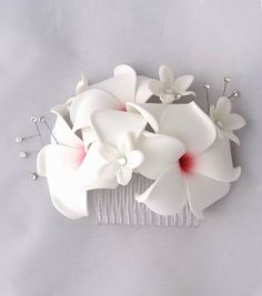 Plumeria Hair Comb - I need something like this for my hair. The girls can get one of these instead of a bouquet if they would prefer.