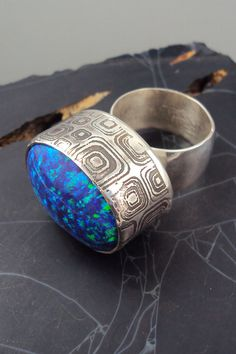 Modern ring with lab opal.