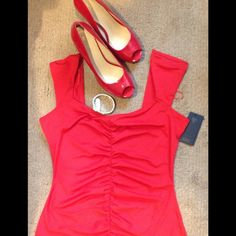 GUESS RUCHED SWEETHEART-NECK TOP Super cute sweet-heart neckline with cap sleeves.  Adding a flirty flavor with ruched detailing in the front. Hits at the hip. Great with your favorite skirt or pants. Guess Tops