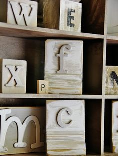 Wooden blocks with cardboard letters.