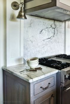 Elegant Kitchen Design Featuring Gorgeous Nickel Bell Sconces Installed  Above Wire Brushed Oak Kitchen Cabinets Paired With Calcutta Gold  Countertops ...