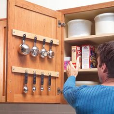 Don't let small stuff occupy valuable drawer and shelf space. Equipped with cup hooks, the backs of cabinet doors can hold measuring cups, spoons and other hanging items.