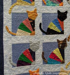 The Crazy Cat Lady by Kaye Winalis, 2014 Tucson Quilters Guild show, closeup photo by Quilt Inspiration. Grandma's Fan pattern in The Cat's Meow by Janet Kime.