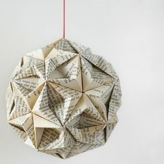 Christmas origami bauble - instructions found here: http://www.youtube.com/watch?v=hIF8RgdSrO8