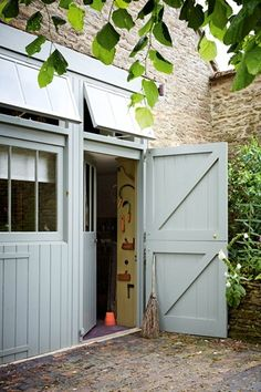 Accessed from the outside only, a storage room holds gardening tools