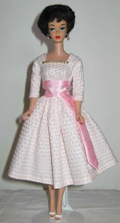 Beautiful OOAK dress on a bubblecut Barbie from the collection of Steen Michael Thompson.