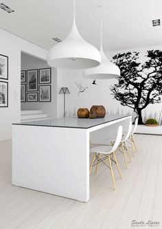 Black & White. Always works. Notice the supersized pendant lights?