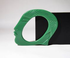 Rare and chunky Bill Schiffer face bangle. This piece is modeled after Josephine Baker in green Resin.