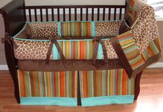 Madagascar Baby Bedding  This custom 3 pc baby crib bedding set includes the bumper pad, crib skirt, and blanket.  The multi color stripe, aqua twill, chocolate grosgrain ribbon, Minky giraffe, and ultra chocolate minky combine softness and texture. The best for your little angel's nursery.