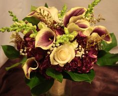 This rich colored fall wedding took place at the beautiful Polish Center of Wisconsin. Fall Wedding, Floral Design, Succulents, Floral Wreath, Classy, Wreaths, Bride, Purple, Plants