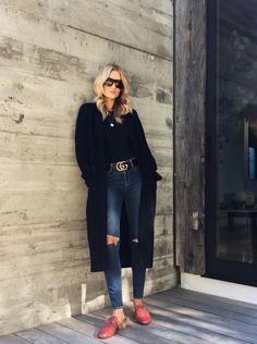 black coat, skinny jeans, red mules