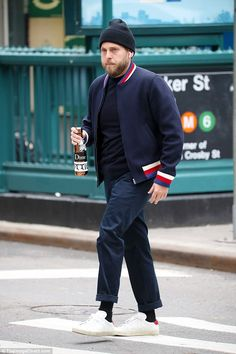 Cool and casual: Jonah Hill has embraced an edgier sense of style since his lifestyle overhaul, cutting a stylish figure when he stepped out in New York City on Friday