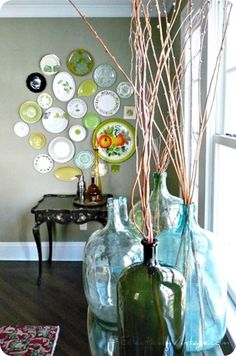 home decor in blue and green - glass bottles and wall plates