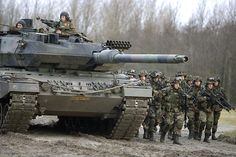 Dutch Leopard 2A6 main battle tank and infantry during training.