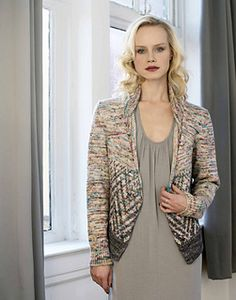 Standard-fitting cardigan with Fair Isle patterning, front bust shaping, and rolled collar. Sized for Small, Medium, Large and shown in size Small on pages 36 and 37.