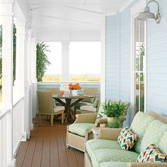 Pleasing Palette - The deck of our Cinnamon Shore, Texas, Showhouse has it all: a perfectly situated dining nook and a cozy conversation nook. The green Sunbrella fabric mingles softly with the pale blue exterior walls, and punchy geometric throw pillows enliven the space. 65 Beachy Porches and Patios - Coastal Living